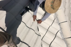 Fixing broken roof tiles