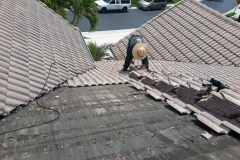 Carefully removing old roof tile