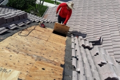 Laying down new roofing materials