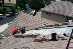 Stripping away the old roofing materials
