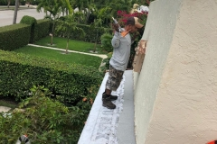 Roofing professional on roof