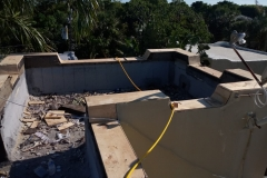 Stripping away old roofing materials